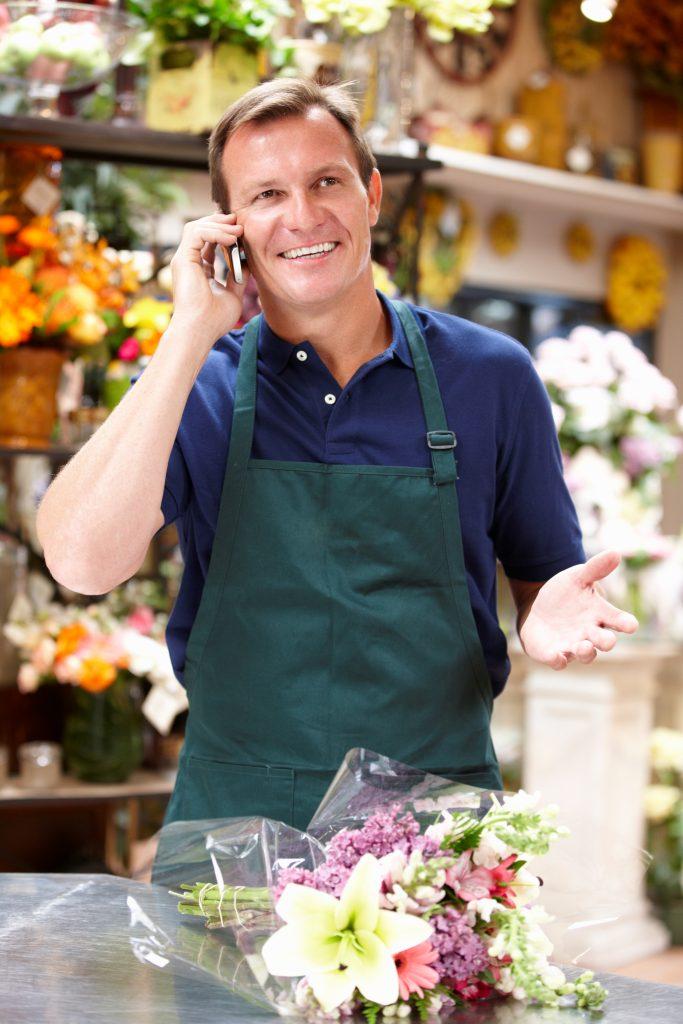 Florist Taking Orders for Flower Deliveries