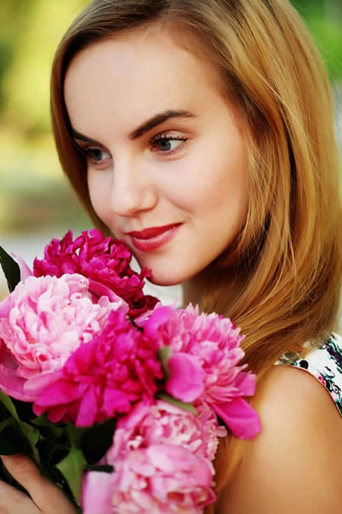 Flower Delivery - Girl Smiling with Delight